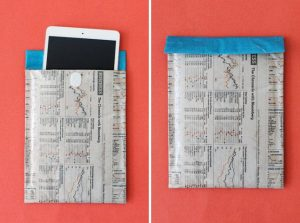 An old envelope reused as a phone holder.