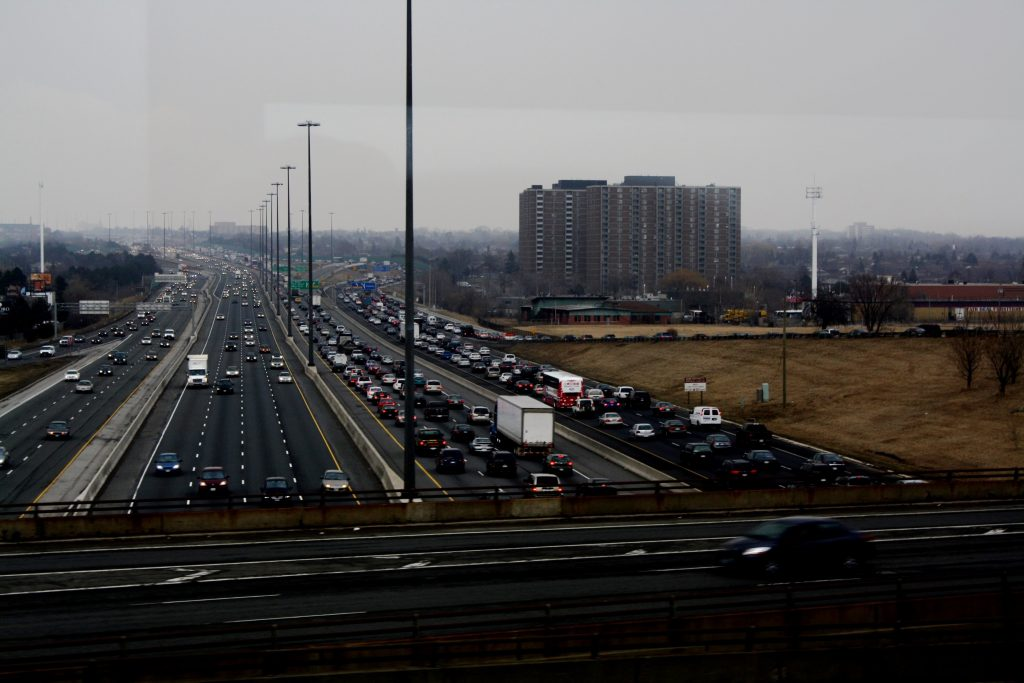 Photo of 13 lanes of traffic, with an overpass.