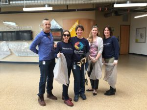 Five Green Team staff members, participating in a clean up.